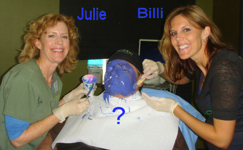 Photo of Billi and Julie molding Dr. K's face for Kids Day at the Clay County Fair 2011