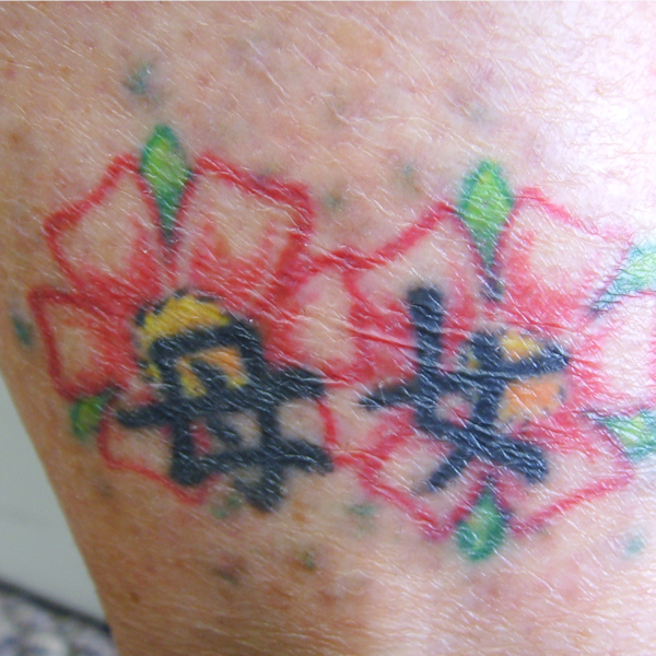 Photo of multicolored tattoo after blue birds were treated many times